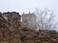 Torá: La torre del campanar amb boira  Carmen Aparicio